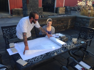Jess reviewing the architectural plans for Emma Willard's buildings